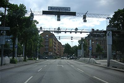 three gantries in Stockholm, Sweden that hold the surveillance cameras for automatic toll-collecting.