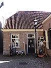 foto van Eenvoudig witgepleisterd huisje