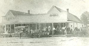 Pea Ridge, Arkansas - The original J.J. Putnam's general merchandise store, which later burned down and was replaced with a cement block building, which still stands on the southeast corner of Pickens Road and Curtis Avenue. This photo antedates 1914.