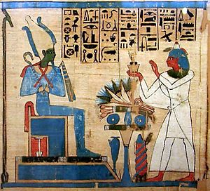 Funerary cult - Osiris, depicted as a mummy, receives offerings on behalf of the dead in this illustration on papyrus from a Book of the Dead.