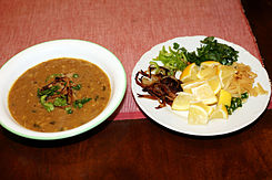 Pakistani Haleem served with garnish.jpg