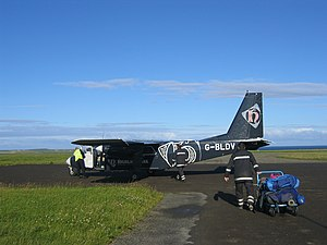 Westray to Papa Westray flight - Britten-Norman Islander being loaded for departure from Papa Westray