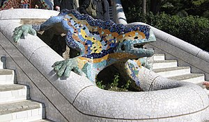 "Park Güell - Gaudí's multicolored mosaic salamander, popularly known as ""el drac"" (the dragon), at the main entrance, as restored after the vandalism of February 2007"