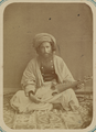 Pastimes of Central Asians. A Musician Playing a Rubab, a Fretted Lute-like Instrument WDL10826.png