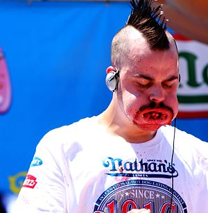 Patrick Bertoletti - Patrick Bertoletti fills his mouth with franks in the 2010 Nathan's Hot Dog Eating Contest.
