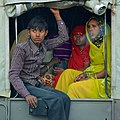People in a jeep, Mathura, India, 2013-03 (11552221334).jpg
