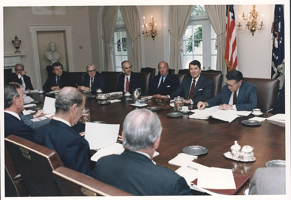 file photograph of president reagan leading a cabinet