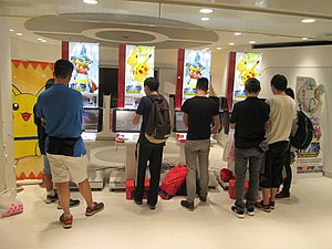 Pokkén Tournament - People playing Pokkén Tournament in Sunshine City, Tokyo.