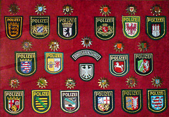 Law enforcement in Germany - Sleeve and cap ensigns of the 16 state police forces and the Bundesgrenzschutz (Federal Border Guard)