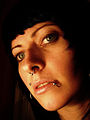 Portrait of dark haired girl with beautiful eyes and several piercings.jpg