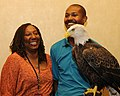 Posing for picture with Bald Eagle. (10594546116).jpg