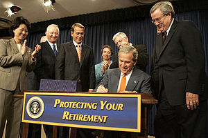 President George W. Bush signs into law the Pension Protection Act of 2006