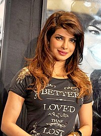 A photograph of Priyanka Chopra looking forward, smiling and posing for the camera
