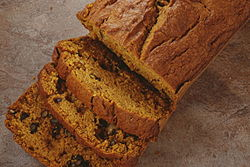 A delicious loaf of homemade pumpkin walnut bread.