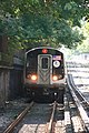 Q train arriving at Newkirk Ave station.jpg