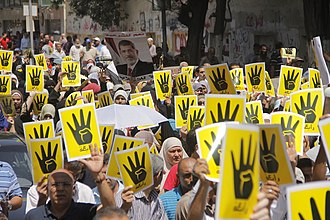 Post-coup unrest in Egypt (2013–2014) - Demonstrators holding the Rabia sign in solidarity with the victims of the 14 August massacre of pro-Morsi sit-ins in Cairo.