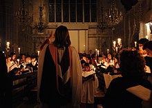 church choir singing by candlelight
