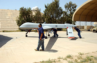 General Atomics MQ-1 Predator - Three contract maintainers walk an RQ-1 into a shelter at Balad Air Base, Iraq in 2006.
