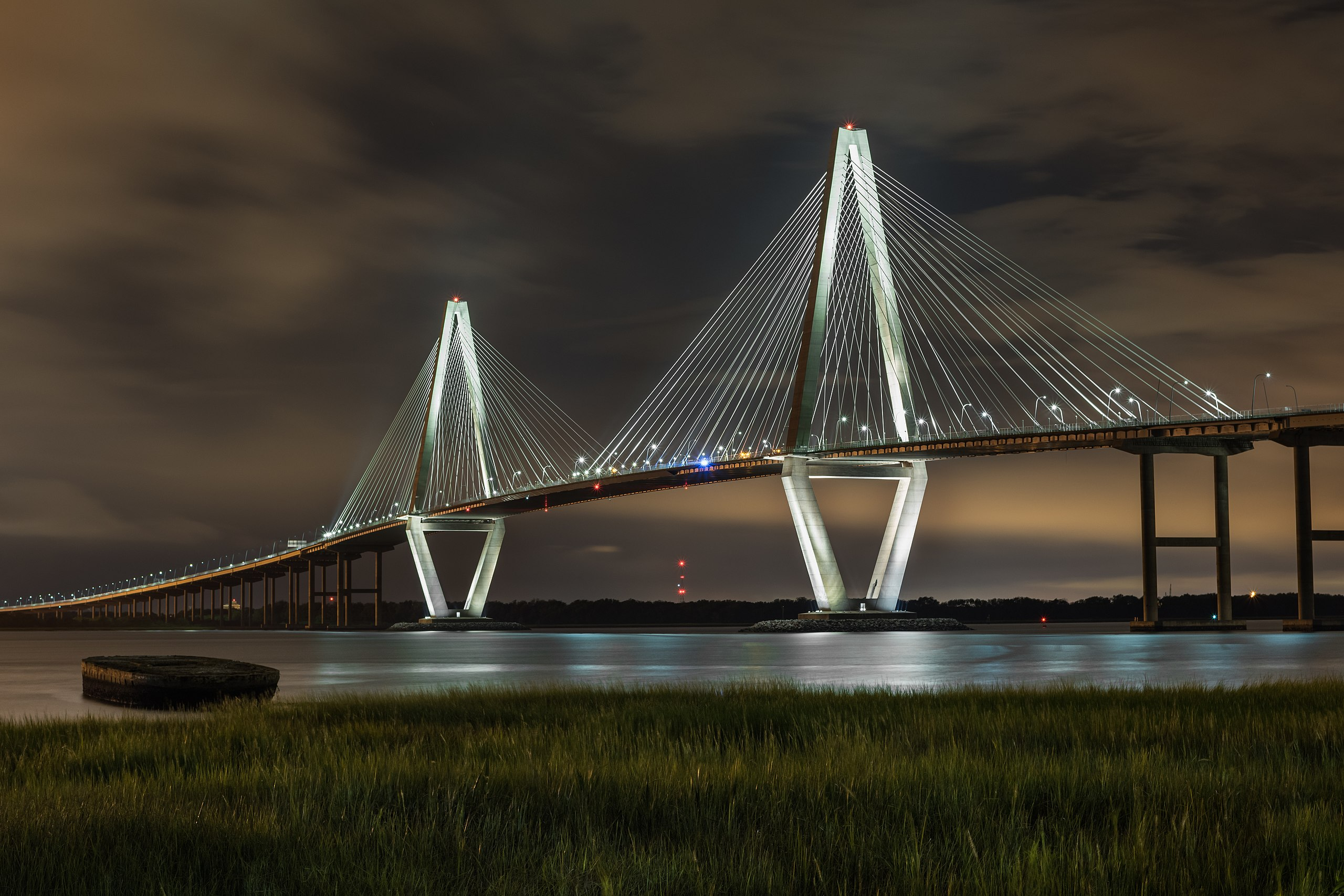 A nighttime picture of the Arthur Ravenal Bridge which connects Mount Pleasant to Charleston.