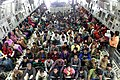 Rescued people onboard an IAF C-17 Globemaster aircraft being carried to Delhi on September 15, 2014.jpg