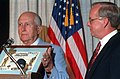 Retired Adm. Thomas Moorer presents a plaque to H. Lawrence Garrett III.jpg