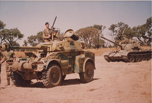 Troops of the Rhodesian Armoured Corps in 1979. Rhodesian Eland and T-55.jpg