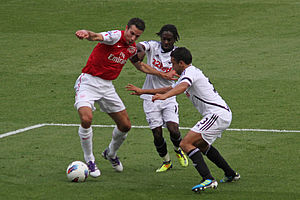 Nathan Dyer - Dyer along with Neil Taylor attempt to tackle Robin van Persie.