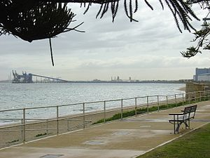 Rockingham, Western Australia - Mangles Bay at Rockingham. In the background, a shiploading facility for wheat, at Kwinana.