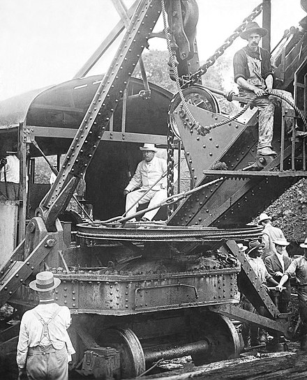 US President Theodore Roosevelt sitting on a steam shovel at the Panama Canal, 1906 Roosevelt and the Canal.JPG