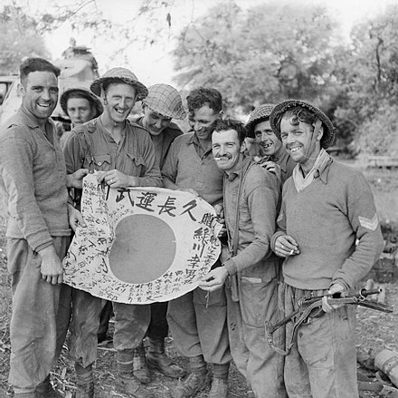 Royal Scots with a captured Japanese Hinomaru Yosegaki flag, Burma, 1945 Royal Scots with flag 01-1945.jpg