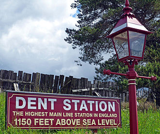 Dent railway station - Altitude sign, preserved gas lamp and wooden snow fence at rear