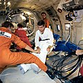 SPACESUIT DONNING AND DOFFING - ZERO-G TRAINING - DON PETERSON - STS-6.jpg