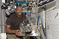 STS-129 ISS-21 Leland Melvin with the failed Urine Processor Assembly in the Destiny lab.jpg
