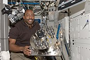 STS-129 ISS-21 Leland Melvin with the failed Urine Processor Assembly in the Destiny lab