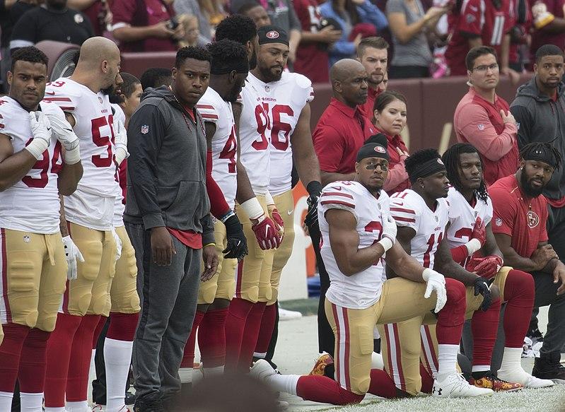 File:San Francisco 49ers National Anthem Kneeling (37721041581).jpg