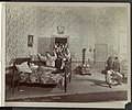 """Scene from """"Little Italy"""" showing Minnie Maddern Fiske lying on bed, Frederic De Belleville kneeling beside her, Claus Bogel seated on table chair with head bowed, and group of people in LCCN93513885.jpg"""