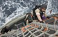 Search and seizure (VBSS) team member of USS Mustin, climbs the ship's pilot ladder after returning from the INS Ranjit.jpg