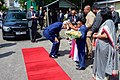 Secretary Kerry Bows to Receive Jasmine Garland From Sri Lankan Children Upon Arriving at Ministry of Foreign Affairs in Colombo (16720069693).jpg