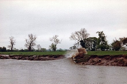 Bore hitting the riverbank in 1994 SevernBore1994.jpg