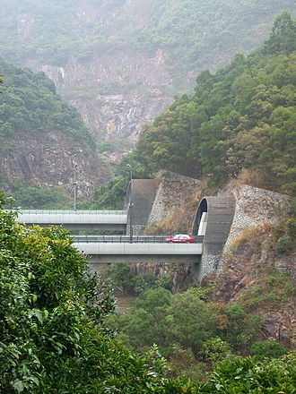 Shing Mun Tunnels - A red taxicab exiting one of the Shing Mun Tunnels