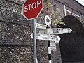 Signposts by railway bridge at Rowlands Castle - geograph.org.uk - 599532.jpg