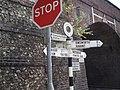 Signposts by railway bridge at Rowlands Castle - geograph.org.uk - 599532.jpg