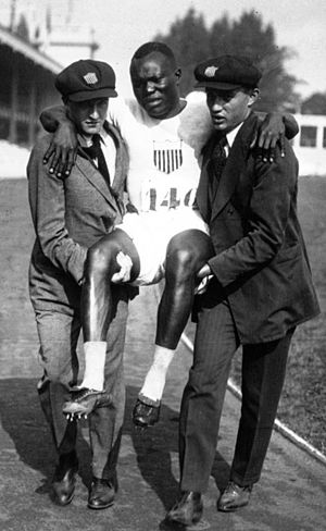 Sol Butler - Butler being carried away after pulling a tendon at the 1920 Olympics