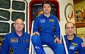 Soyuz TMA-03M crew in front of their spacecraft.jpg