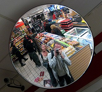 Mirror - Mirror image in a surveillance mirror, which reflects the person taking the photo.
