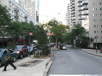66th Street (Manhattan) - Two-way block, between 2nd and 3rd Avenues on an otherwise one-way street. Manhattan House, a New York City Landmark, on the right.