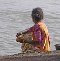 Squatted woman in Negombo Sri Lanka.jpg