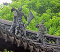 Statues of soldiers on roof, Yuyuan Gardens.jpg
