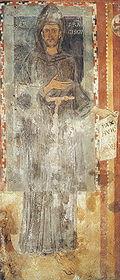 São Francisco de Assis vestindo os trajes típicos da ordem que criou