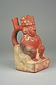 Stirrup Spout Bottle with Figure on Throne MET 64.228.49.jpeg